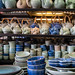 Bangkok, Thailand - November 30, 2019: Handcrafted pottery, teapots and dishes for sale at a stall in Chatuchak Weekend Market