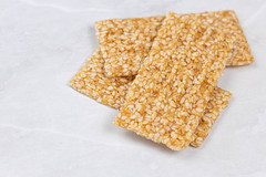 Sesame Bars pile on the grey marble table