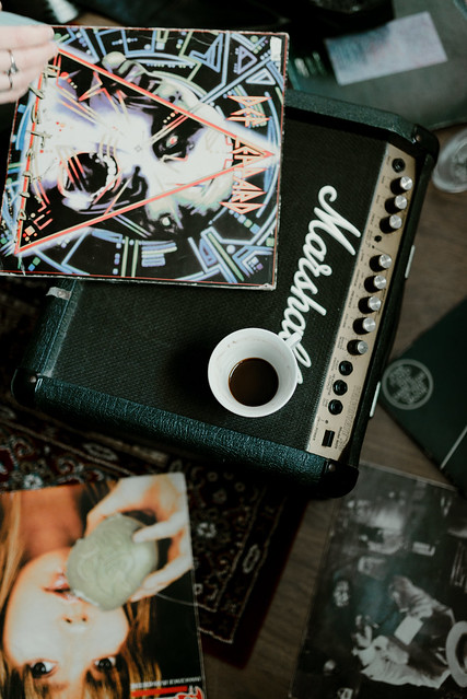 Photo:Cup of coffee and vinyl on the amplifier. By shixart1985