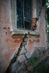 Damaged wall of the old abandoned house.