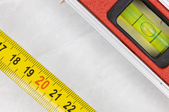Measuring Tape with Level in Construction Concept