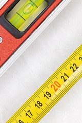 Measuring Tape with Level in Construction Concept with copy space