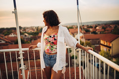 Portrait of attractive woman on the balcony.