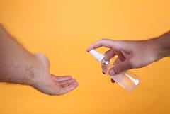 Applying sanitizer gel