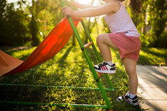 Young girl climbing on the slide.