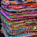 Colorful textile fabrics for sale at Dilli Haat New Delhi India, a market filled with colorful handicrafts and handmade items