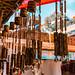 Wooden windchimes with musical bells for sale at Dilli Haat, an outdoor handicraft bazaar market in New Delhi India
