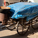 Traditional street cart with wok food cart in New Delhi India, parked on the side of a road, covered with tarp