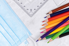 Top view Wooden Colorful pencils with Rulers and surgical masks for virus protection