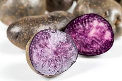 Close-up, purple ripe potato halves