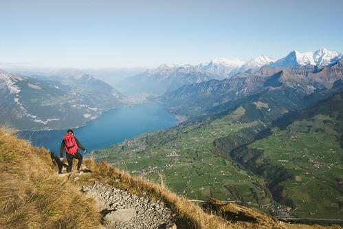 Caroline Hiking down from the peak of Niesen to lake Thun on a sunny day, Switzerland