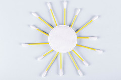 A sun made from a cotton pad and cotton swabs