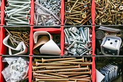 Set of fasteners and screws in a box