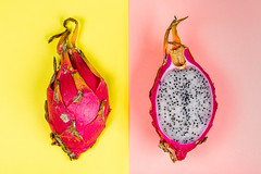 Top view, dragon fruit on pink and yellow background