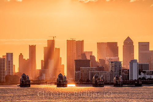 Let us paint the town gold! London's Canary Wharf Skyline, the Thames Barrier and the Thames