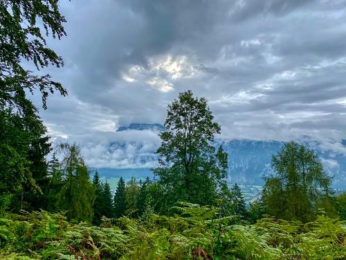 Zahmer Kaiser mountains shrouded in clouds seen from Nußlberg near Kiefersfelden in Bavaria, Germany