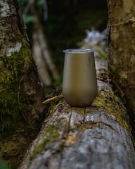 Mug on log