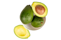 Top view, fresh avocado in a bowl on white