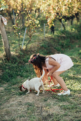 Girl and the curious dog in the vineyard.