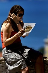 Girl Reading and talking through the mobile phone
