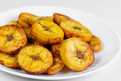 Fried plantain on a white plate, close-up