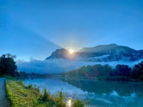 Sunrise over Zahmer Kaiser mountains and the river Inn near Kiefersfelden in Bavaria, Germany