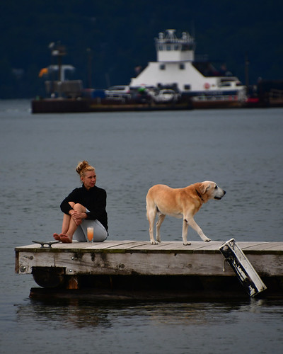 Woman with dog on dock, Madeline Island