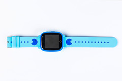 Blue smart watch on white background, top view