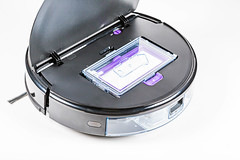 Close-up, robot vacuum cleaner with open top cover