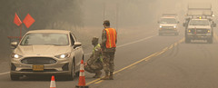 Oregon Army National Guard Soldiers man traffic control points to protect citizens from fire hazards