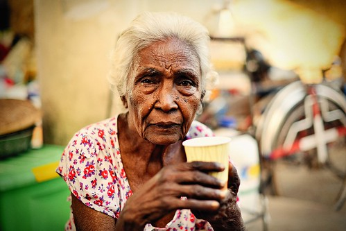 A local woman having a tea break