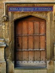 Astronomers' and rhretoricians' door, University of Oxford, England.