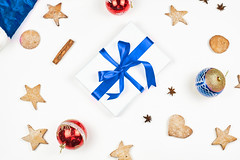 Bright Christmas background with festive cookies, ornaments and present box