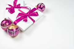 Giftboxes tied with purple-colored ribbons and large copy space