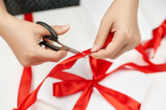 Woman finishing wrapping New Year gift