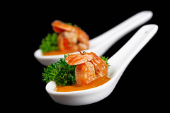 Delicious shrimps with mango sauce and parsley