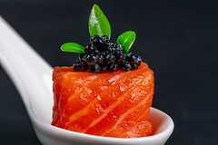 Close-up, fillet of red fish with black caviar