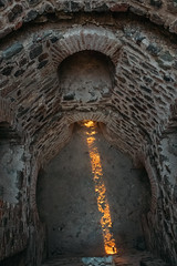 A beam of sunlight illuminating shades in the fortress
