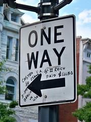 """Graffiti on """"ONE WAY"""" sign"""