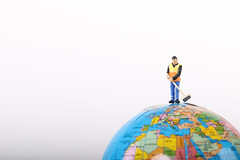 Man holding a broom and  cleaning the globe concept