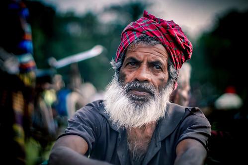 A Bangladeshi farmer sitting at local food market.