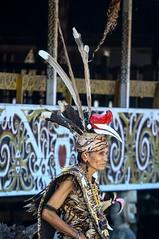 Man wearing traditional dayak costum