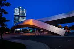 BMW office headquarters in Munich, behind the irregular and artistic metal bridge of the exhibition space BMW-World.