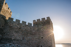 Sun behind the Ram fortress walls on the Danube river