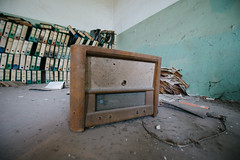 Old vintage radio in the office room of the old abandoned school.