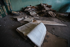 Old book on the floor of the old abandoned school.