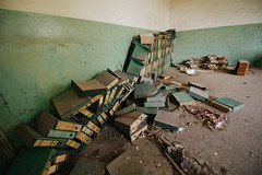 A pile of old office accessories in the abandoned school.