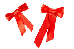 Set of two beautiful handmade gift bows made of bright red silk ribbon