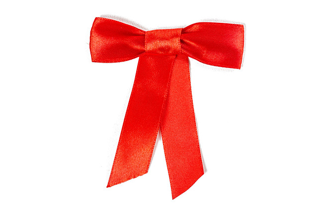 Photo:Red bow on a white background By wuestenigel
