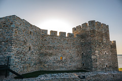 Light coming through the window in the middle of the fortress wall